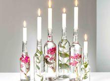 Dancing Pixies Blüten in Glasflaschen mit Kerzen
